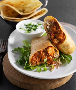 Show the Look of a butter chicken wrap and the spices used in it.